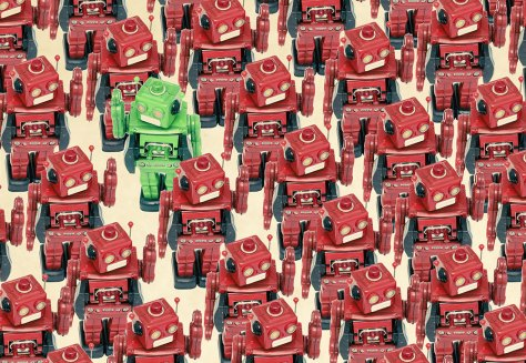 green robot in sea of red robots