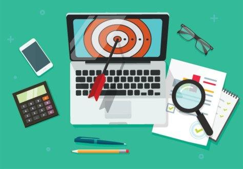 target marketing illustration of laptop with bullseye