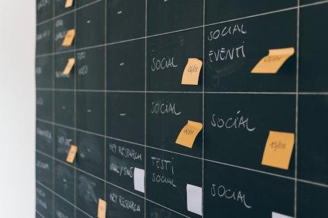 post-it notes on a blackboard calendar