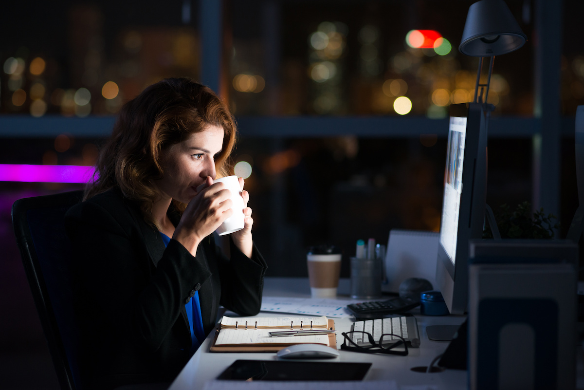 woman working at computer at night