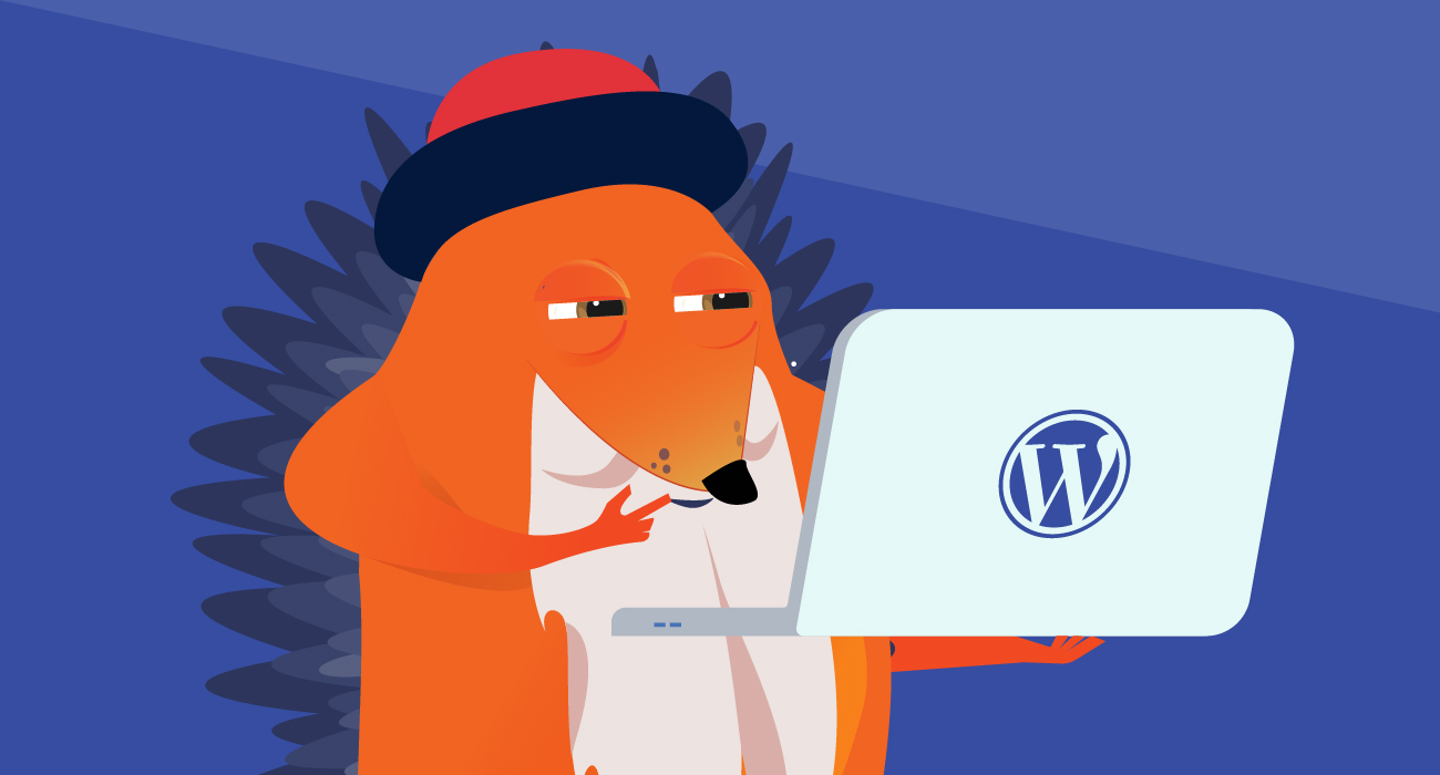 Hedgehog Gutenberg looking at WordPress on a laptop