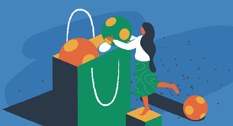 woman adding balls to a shopping bag