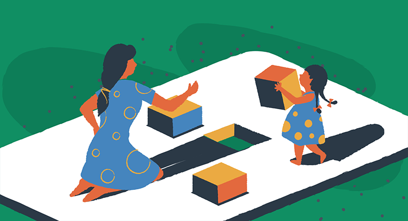 woman and child building with blocks