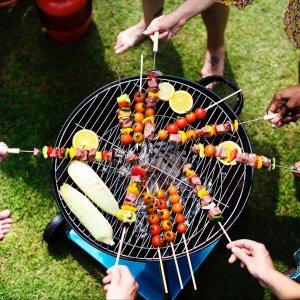 People Grilling Kebabs