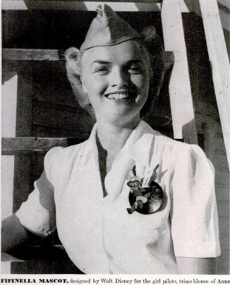 Member of Women Airforce Service Pilots (WASP) wears Fifinella patch on blouse, 1943