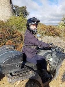Nancy in a crash helmet on a quad bike