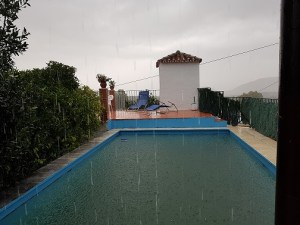 A full swimming pool in the rain