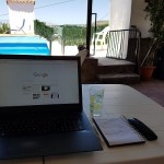 Laptop outside under a terrace