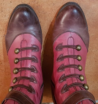 Brown and red boots with button fastening