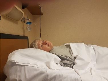 An unhappy Nancy lying in a hopital bed