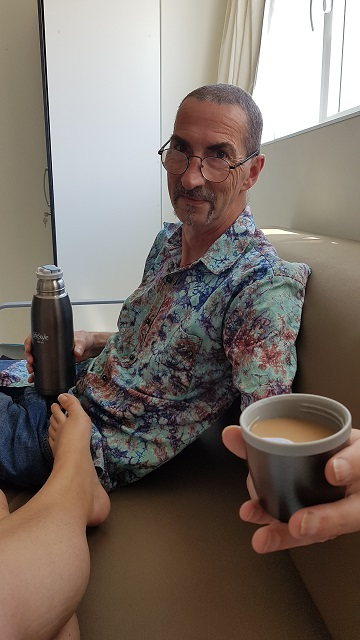 Rob holding a flask of tea