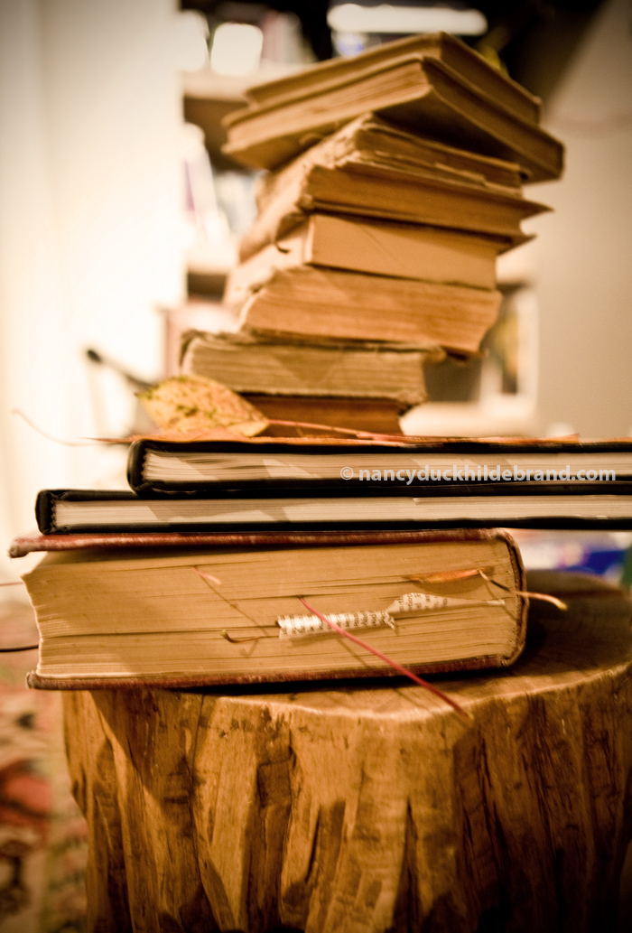 Pressing leaves under a stack of books