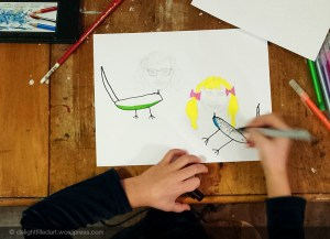 child drawing budgies