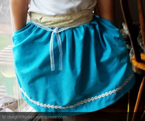 child wearing handmade skirt