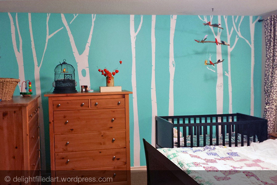 birch trees painted on turquoise wall