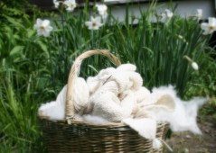 basket of handknit blanket and handspun cashmere yarn