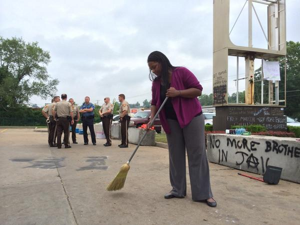 A woman cleaning up in Ferguson