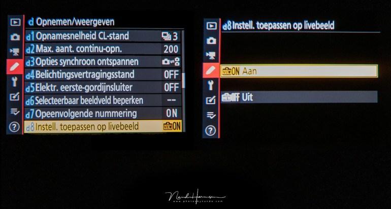 Door de belichtingssimulatie uit te schakelen via het menu, zal het beeld niet de ingestelde belichting weergeven.