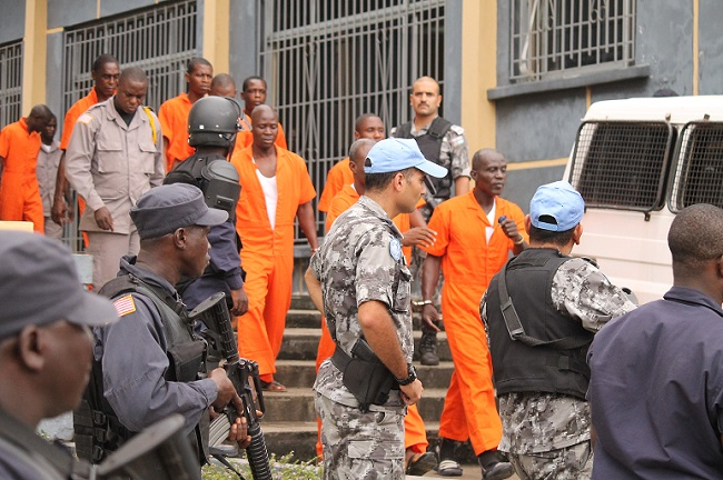 Convicts being led back to jail by security officers