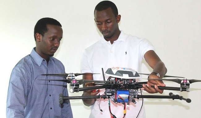 Rutayisire (left) and Segore put one of their drones on display Photo: New Times/Moses Opobo
