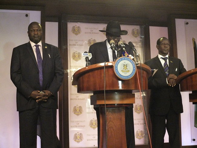 South Sudan President Salva Kiir (in hat) with Vice President Riek Machar (left) and Vice President James Wani Igga at a press conferenceas fighting broke out on 8 July. Photo: Samir Bol