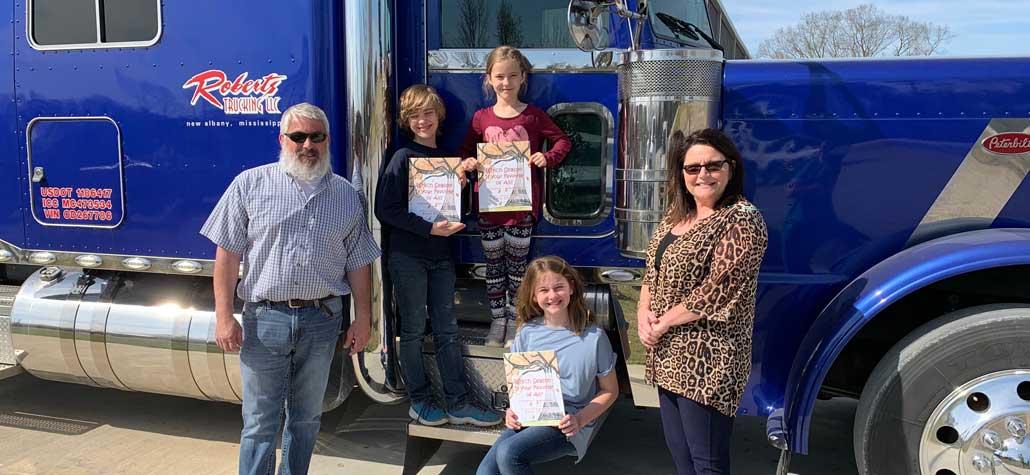 New Albany MS Roberts Trucking books donation