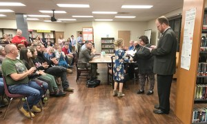 school presents certificates to students for perfect scores
