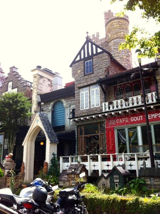 Cafe Gout Temps tea shop with minitatures in front and castle parapets.
