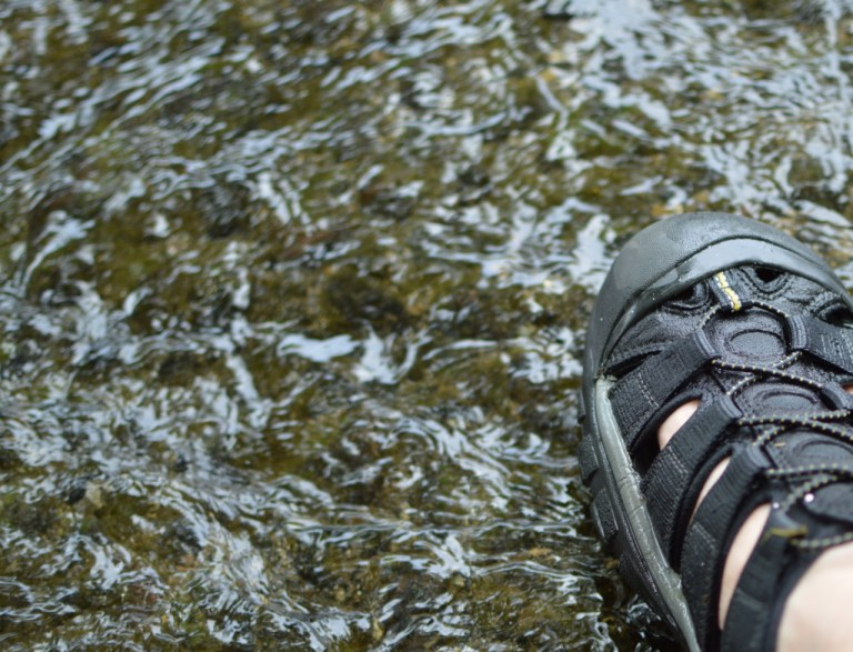Feet in water to cool off in the summer heat