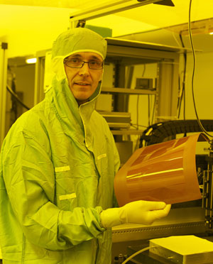 IBM scientist Roger Dangel holds a thin film polymer waveguide