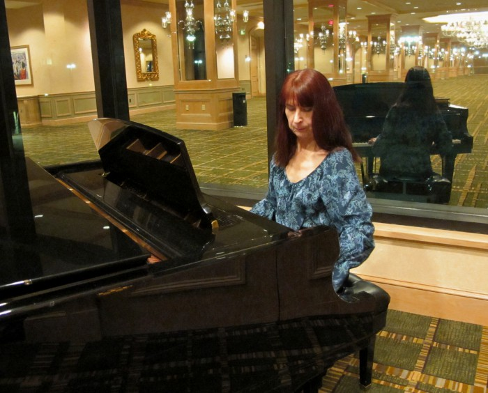 Shirley Nuhn playing the piano at the recent 2013 NANPA Summit in Jacksonville.