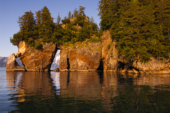 Three Hole Point, a unique rock formation in Aialik Bay in Kenai Fjords National Park, Alaska. © Jerry Ginsberg