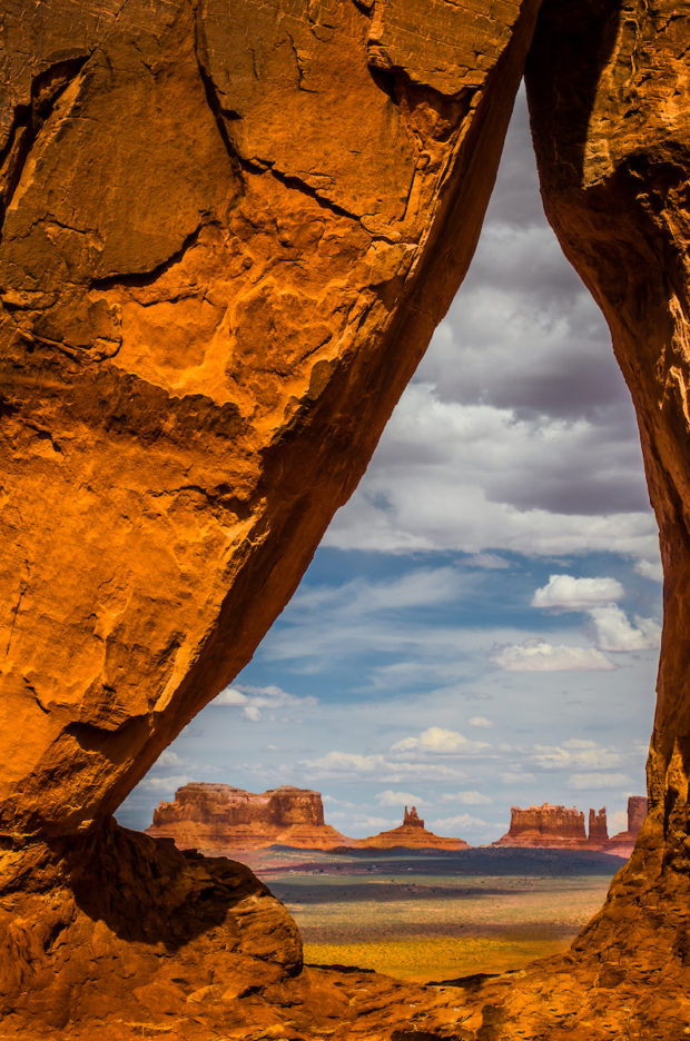 View of Monument Valley formations through Teardrop Arch.