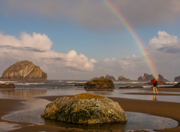 The photographer at the end of the rainbow, Bandon Beach, Oregon.