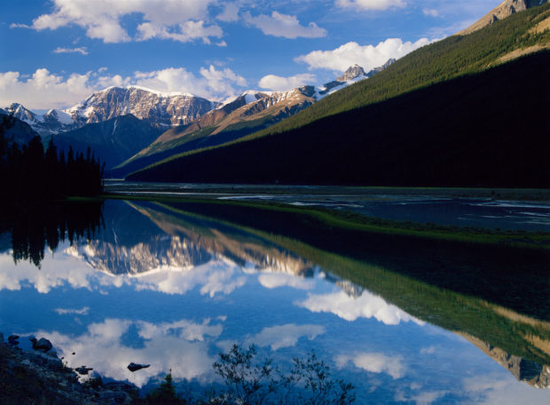 Rugged Rocky Mountains reflect in Crystal blue Studfield Lake, Jasper National Park, Alberta, Canada.