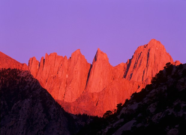 The highest peak in the contiguous 48 states, at 14,496 feet, serrated Mt. Whitney rises among the mountains of the Eastern Sierra.