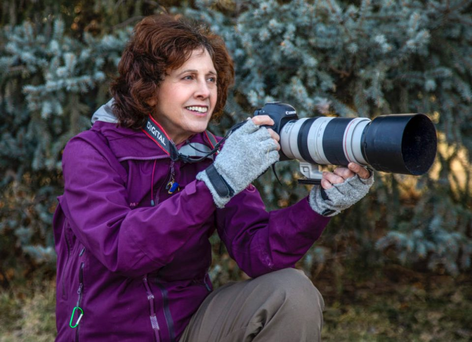 Photographer Wendy Shattil in the field with camera
