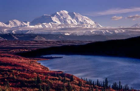 Photo of snow-covered mountain in background with lake in foreground. While timing my visit to mighty Denali to coincide with the peak of the late summer color in the tundra, I was able to camp just a half mile from Ansel Adams Point. Fuji GSW-690, 65mm, Velvia.