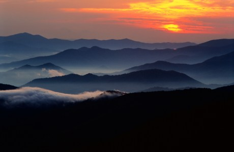 Photo of a brilliant sunset from atop Clingman's Dome in Great Smoky Mountains National Park, the most visited National Park in the country with a deferred maintenance backlog of $235 million.