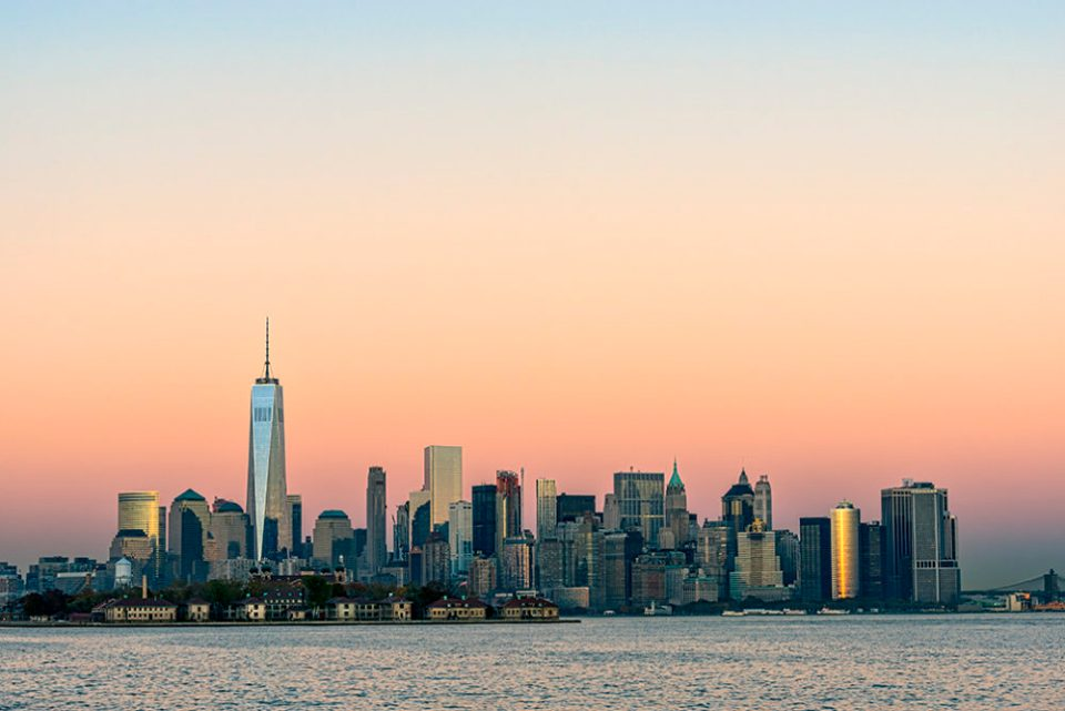 "Photo of New York at sunset. Effective use of negative space can ""tame"" the Manhattan skyline. ©  F.M. Kearney"