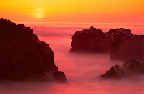 A dramatic Pacific sunset paints the sky in Garapata State Park, Big Sur, California. © Jerry Ginsberg