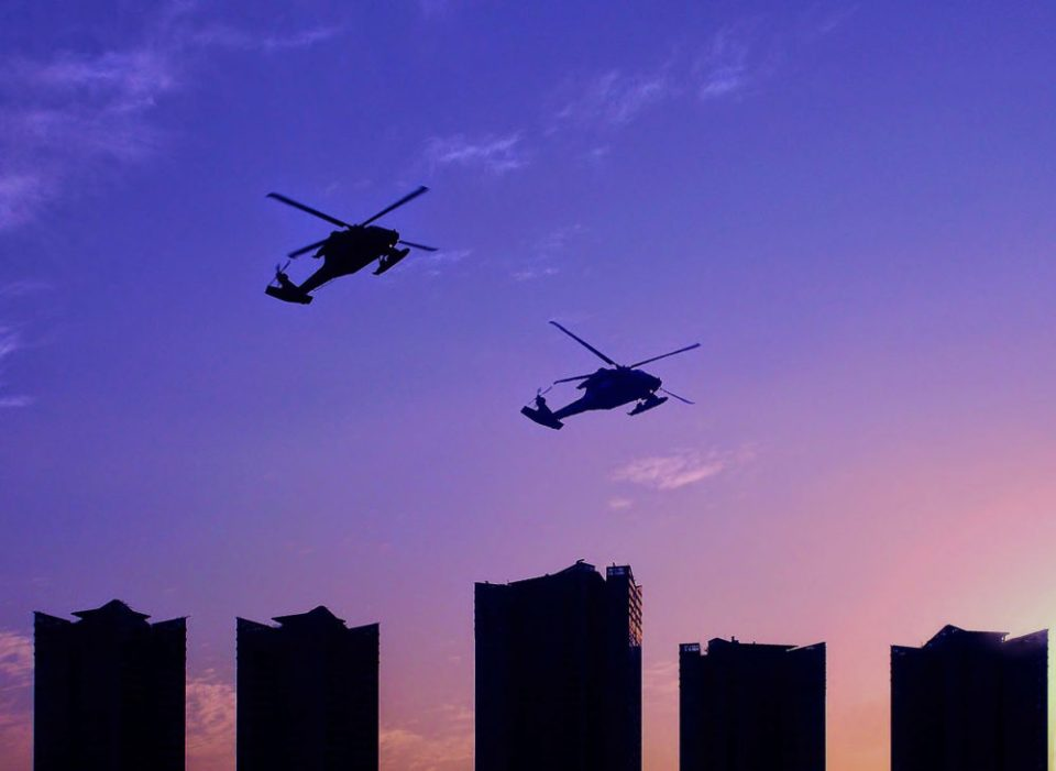 "Photo of helicopters flying over Seoul skyline at dusk. ""Sunset in Seoul"" - South Korea, 2013 © Ryan Reynolds"