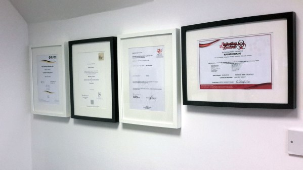 Certificates are clearly on display at NAOHOA Luxury Bespoke Tattoos, Cardiff, Wales (UK).