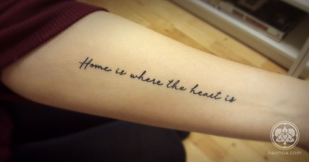 "Tattoo of the quote, ""Home is where the heart is"" on a woman's inner arm. Designed and tattooed by Naomi Hoang at NAOHOA Luxury Bespoke Tattoos, Cardiff (Wales, UK)."