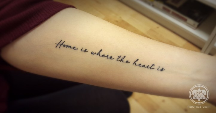 """Tattoo of the quote, """"Home is where the heart is"""" on a woman's inner arm. Designed and tattooed by Naomi Hoang at NAOHOA Luxury Bespoke Tattoos, Cardiff (Wales, UK)."""