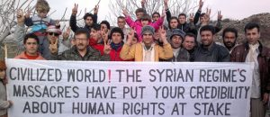Demonstrators protest against Syria's President Assad after Friday prayers in Kafranbel