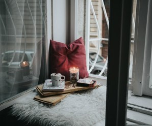 Cozy holiday window with book and candle