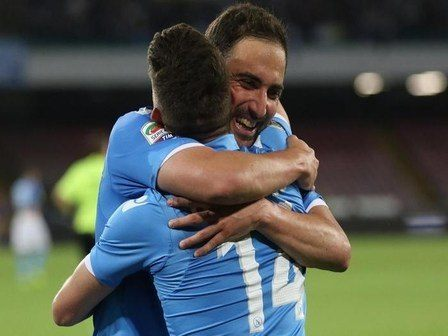 Napoli's forward Gonzalo Higuain exults after scoring the goal of 2-0 during the italian serie A soccer match between SSC Napoli and AC Milan at San Paolo Stadium, Naples, 03 May 2015. ANSA /  CESARE ABBATE