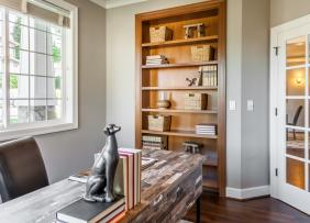 Home office with built in bookcase and natural light