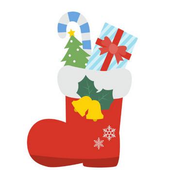 サンタのブーツに入ったクリスマスプレゼント | 無料フリーイラスト素材集【Frame illust】